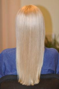 Blonde hair colour with a light grey tint