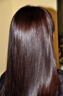 Dark brown hair colour with a purple tinge