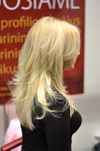 Blonde hair colour with a purple tinge