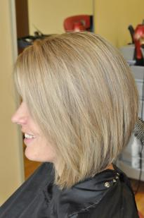 Hair cutting and colouring in highlights